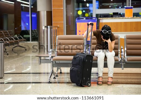 woman was late for a plane at the airport - stock photo