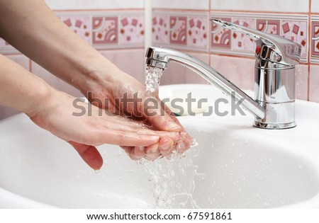 woman wash their hands - stock photo