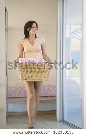 Woman washing clothes - stock photo