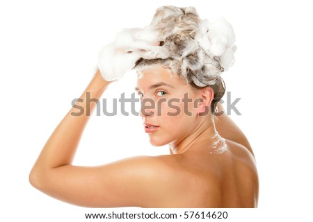 Woman washing hair - stock photo