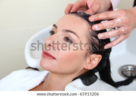 woman washing hair in salon pool - stock photo