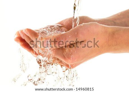 Woman washing hands isolated over white background - stock photo