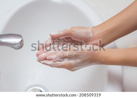 Woman washing hands with soap . Cleaning Hands - stock photo