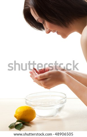 woman washing her face over white - stock photo