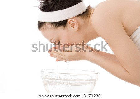 woman washing her face with water - stock photo