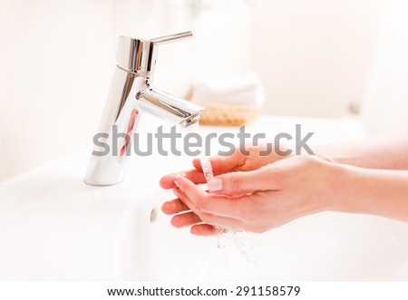 Woman washing your hands in bathroom - stock photo