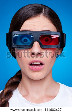 woman watching 3d film in stereo glasses