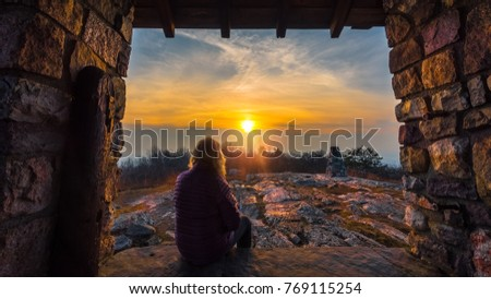 Woman watching the sunset along the Appalachian Trail in Stokes State Forest, New Jersey