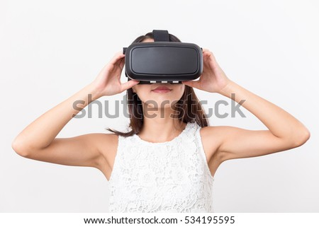 Woman watching though virtual reality glasses