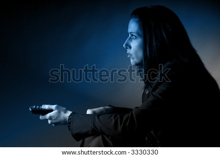 Woman watching TV - stock photo