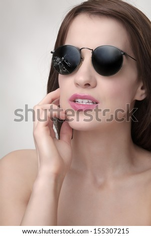 woman wear broken sunglasses - stock photo