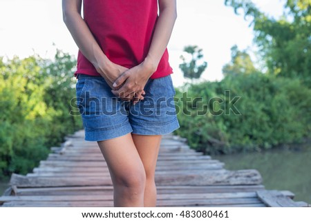 Woman wearing a  denim short, natural background