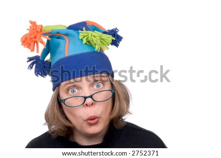Woman wearing a funny court jester winter hat and making a funny face isolated over white - stock photo