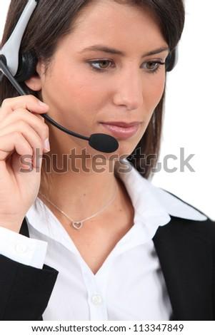 Woman wearing a head-set - stock photo