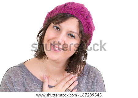 Woman wearing a knitted purple beanie showing her heartfelt gratitude holding her hand to her chest with a lovely sincere smile isolated on white - stock photo