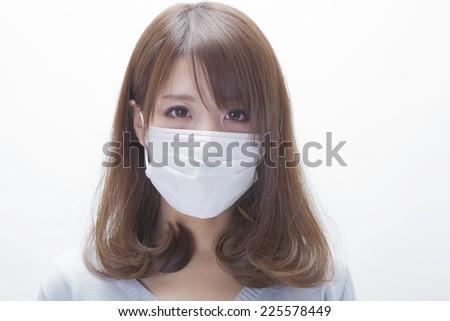 Woman wearing a mask - stock photo