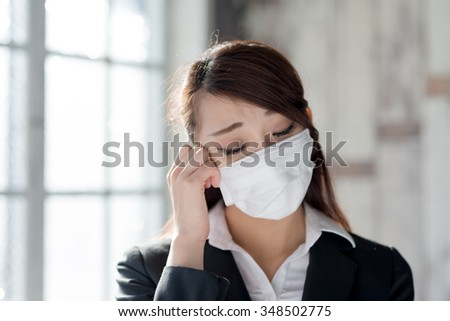 Woman wearing a mask and a cold