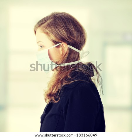 Woman wearing a mask to prevent flu infection. - stock photo
