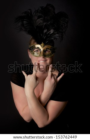 Woman wearing a mask with feathers - stock photo