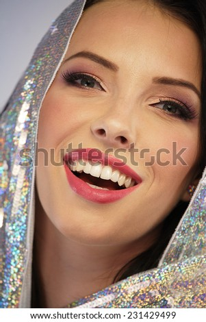 Woman wearing a silver sequin hoodie - stock photo
