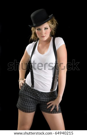 woman wearing a white tee shirt, suspenders and black bowler hat - stock photo