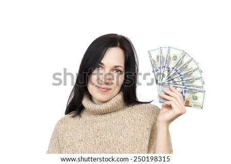 woman wearing beige sweater holding money isolated over white  - stock photo