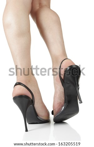 Woman wearing black  heels isolated over white background