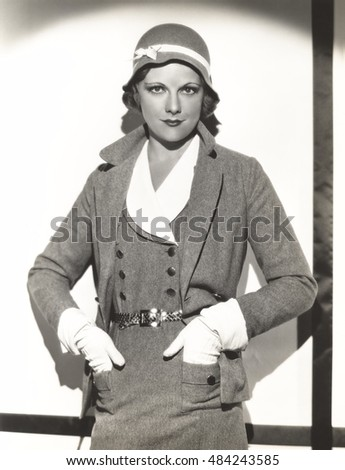 Woman wearing dress suit with matching hat