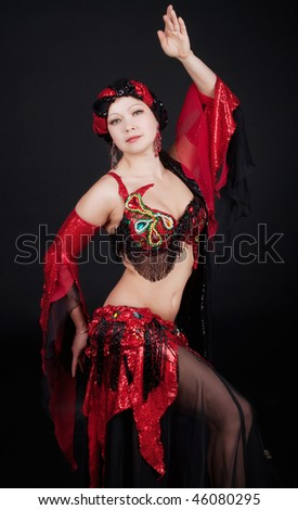 Woman wearing eastern clothes and dancing