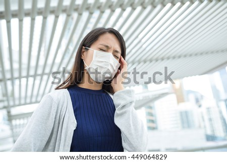 Woman wearing face mask at city - stock photo