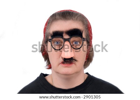 Woman wearing fake nose and glasses with mustashe and eyebrows over a white background - stock photo