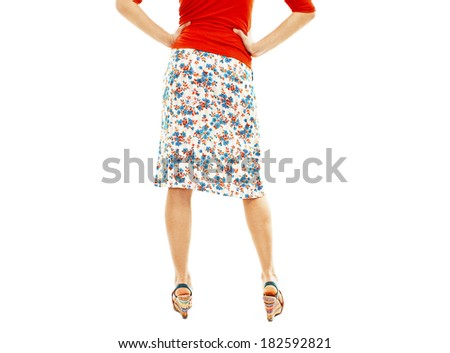 Woman wearing floral skirt and striped sandals  from the back. Isolated on white background  - stock photo