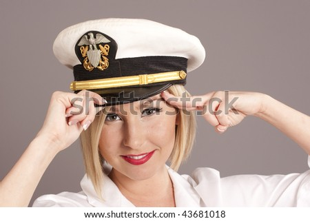 woman wearing generic officers cap saluting - stock photo