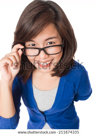 Woman wearing glasses looking up happy smile . Eyewear woman with big smile wearing eyeglasses. Close up portrait of female spectacles model isolated on white background. - stock photo