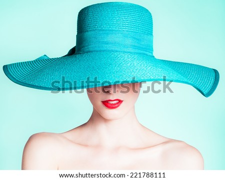 Woman wearing hat. Fashion studio portrait - stock photo
