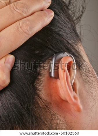Woman wearing hearing aid
