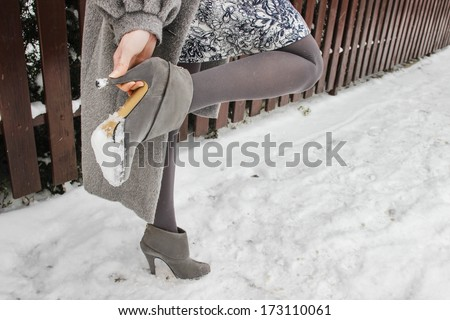 Woman wearing high heels in winter - stock photo