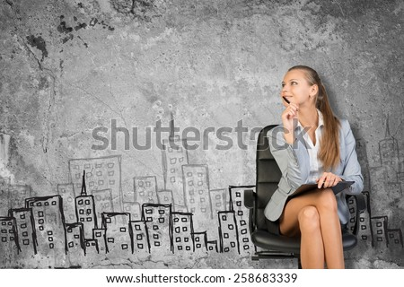 Woman wearing jacket and blouse holding clipboard. Background sketch of buildings - stock photo