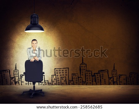 Woman wearing jacket and blouse leaning on chair. Background sketch of buildings - stock photo