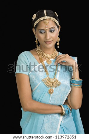 Woman wearing jewelry and day dreaming - stock photo