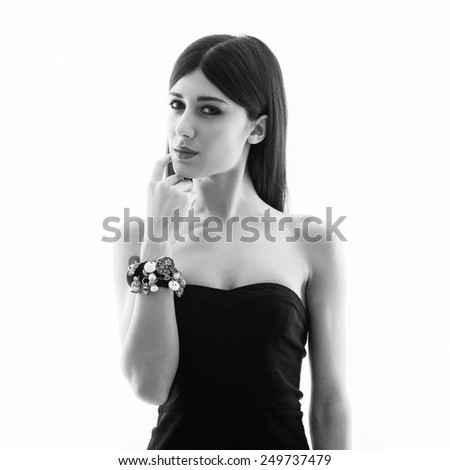 Woman wearing jewelry beauty portrait against white background. Black and white high key image. - stock photo