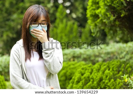 Woman wearing mask - stock photo