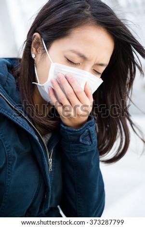 Woman wearing mask - stock photo