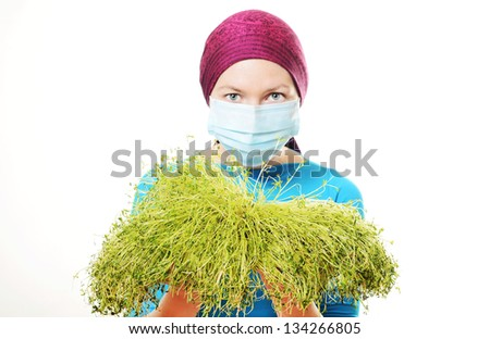 Woman Wearing Mask. Focus on grass - stock photo