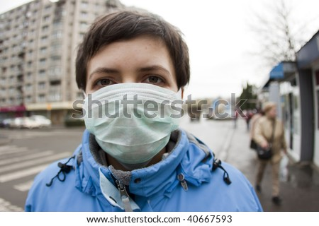 Woman wearing medical mask - stock photo