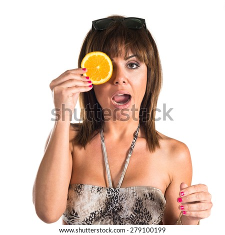 Woman wearing orange slices as glasses