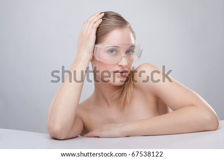 Woman wearing plastic protective goggles. - stock photo