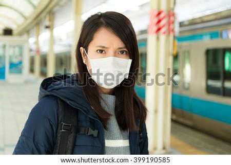 Woman wearing protextive mask - stock photo