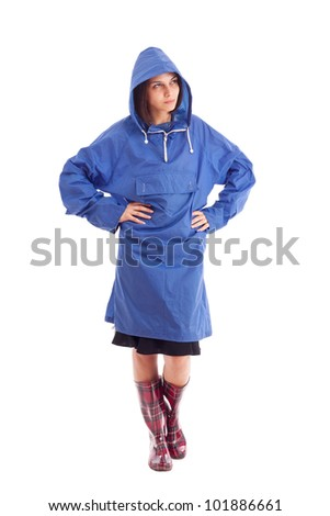 Woman wearing raincoat, isolated on white - stock photo