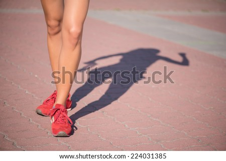 Woman wearing red jogging shoes standing with the bare legs